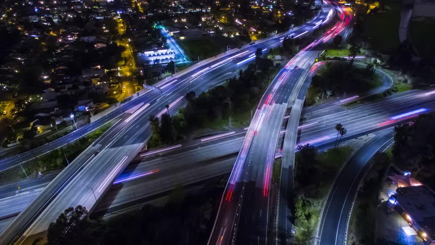 4K Static Aerolapse ( aerial timelapse / hyperlapse ) of the traffic on the freeways interchange. Sherman Oaks, Los Angeles. | Shutterstock HD Video #24215008