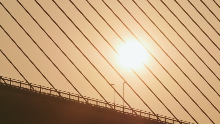 Steel cables of the bridge against the sunset. Bridge in Ha Long city. | Shutterstock HD Video #24226168