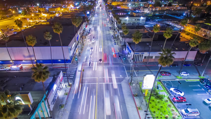 Overhead aerial timelapse view of traffic on illuminated street intersection in Van Nuys, Los Angeles at night. | Shutterstock HD Video #24227437