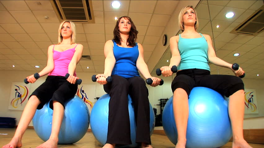 Beautiful girls exercise at the gym - HD stock footage clip
