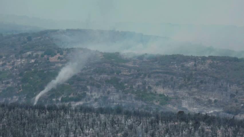 FOUNTAIN GREEN, SANPETE, UTAH 25 JUN 2012: Forest fire tornado twister burn area. Wildfire burns forest mountain violent destruction. Blaze destroyed dozens of homes. Wood Hollow Utah. FEMA - HD stock video clip