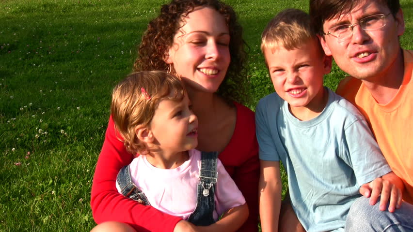 family of four faces singing  - HD stock footage clip