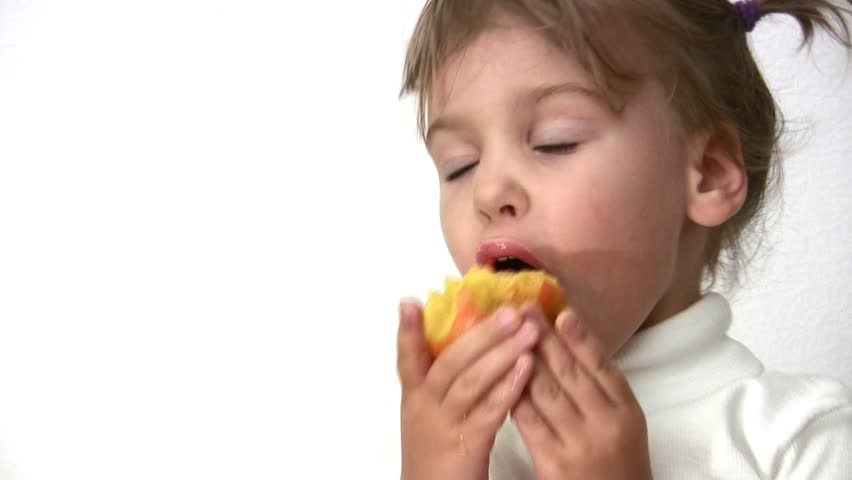 little girl with peach  - HD stock footage clip