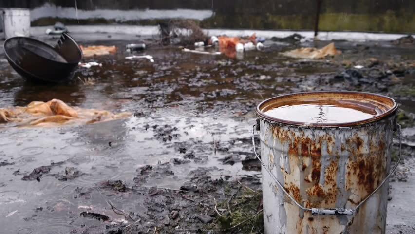 Pollution: Rain on Urban Wasteland.  - HD stock footage clip