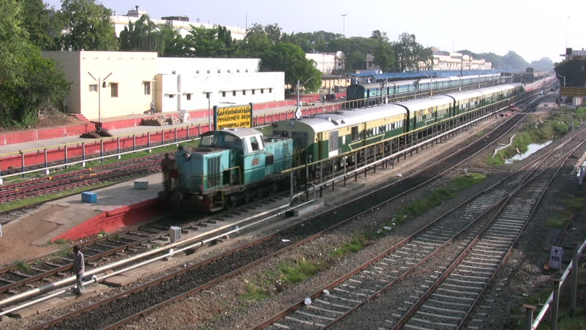 TRICHY - MARCH 20 2008: A train is riding away from the station in Trichy, India