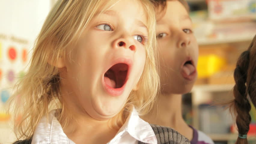Little girl yawing during a lesson in preschool
