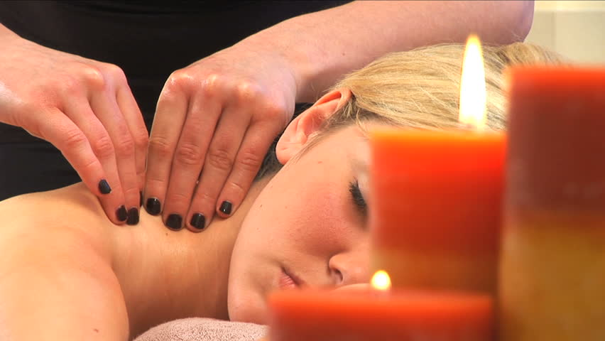 Beautiful woman relaxes while having a massage - HD stock footage clip