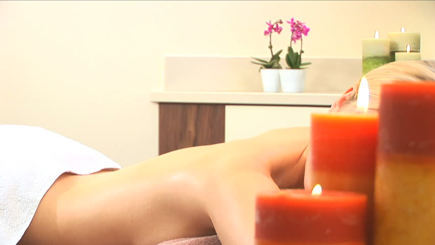 Beautiful blonde girl relaxes during luxury treatment at the health spa - HD stock video clip