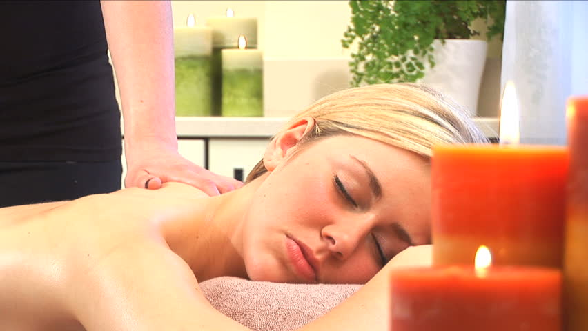 Beautiful blonde girl relaxes during a massage at the health spa - HD stock video clip
