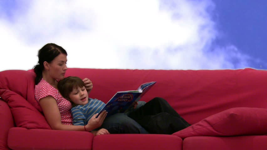 young mother and her son are reading a book  - HD stock footage clip
