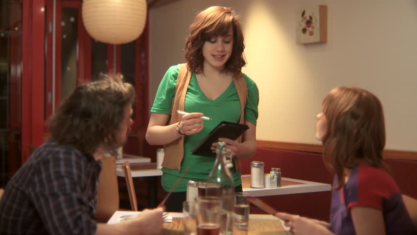 MS, Lockdown, Focus on Foreground, A man and a woman in a cafe ordering from a waitress - HD stock video clip
