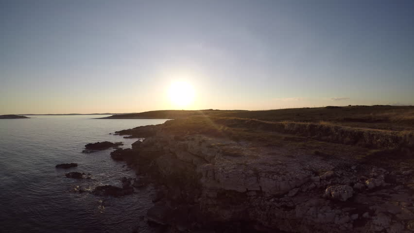 4K: Aerial Sunset on the rocky beach   Shutterstock HD Video #26636566