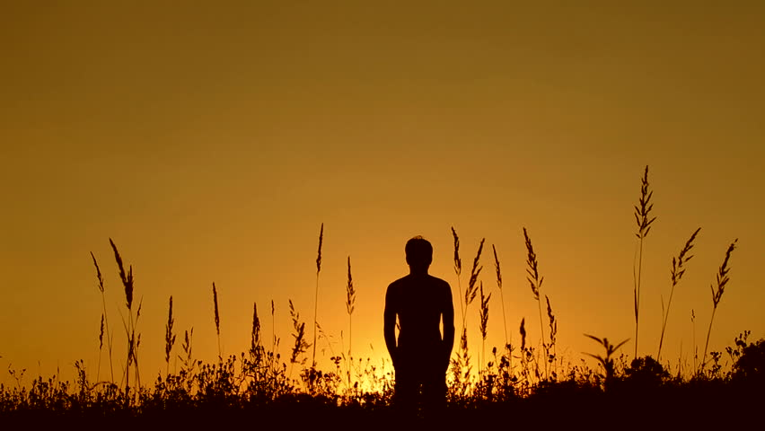 Silhouette of man on the sunset. Harmony concept. - HD stock footage clip