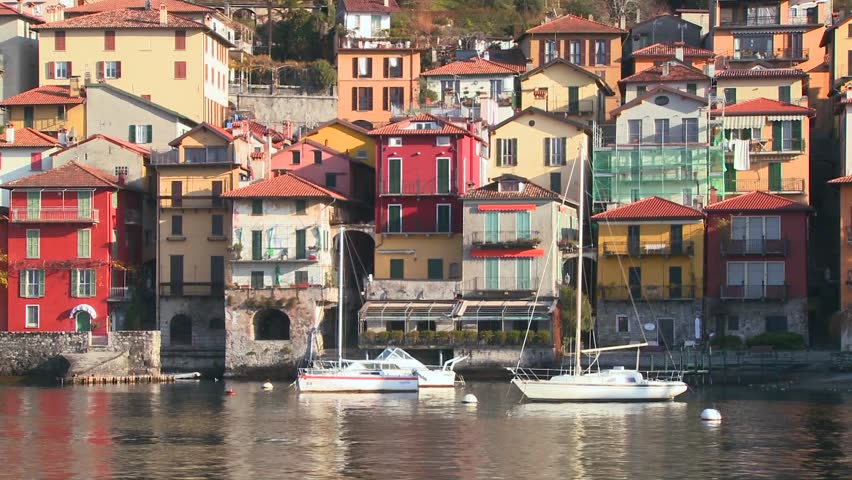 LAKE COMO, ITALY-CIRCA 2011-POV from a boat of the shores of Lake Como with the town of Varenna and the Italian Alps in background.