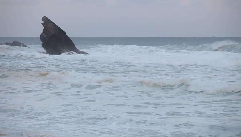 Big stormy waves beside the rocky cliff. Atlantic ocean coastline | Shutterstock HD Video #26888755