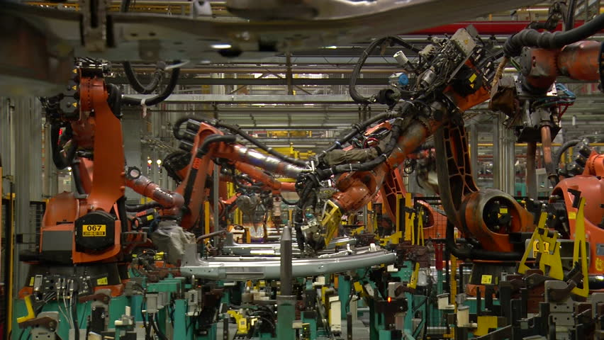 Robots are welding metal in car factory - HD stock footage clip
