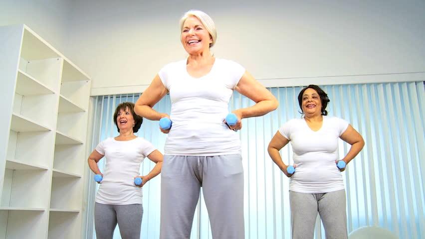 Three multi ethnic retired ladies exercising senior yoga class - HD stock video clip