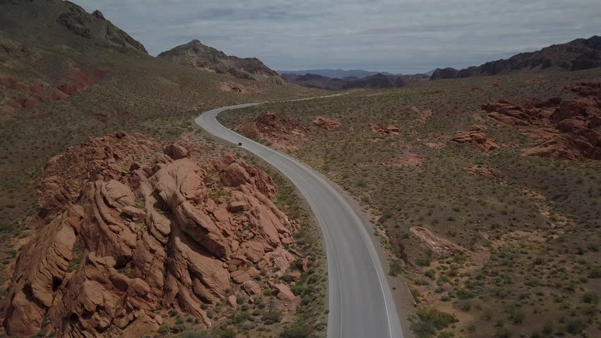 Aerial Nevada desert highway road near Valley of Fire. Near Valley of Fire State Park a public recreation and nature preservation area. Natural ecological tourist tourism destination. | Shutterstock HD Video #27082984