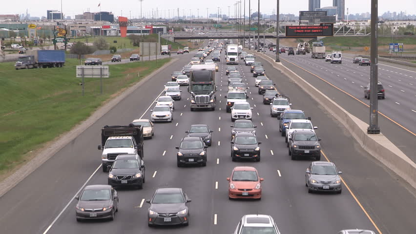 Toronto, Ontario, Canada May 2017 Traffic jam and gridlock on highway heading away for long holiday weekend | Shutterstock HD Video #27119335