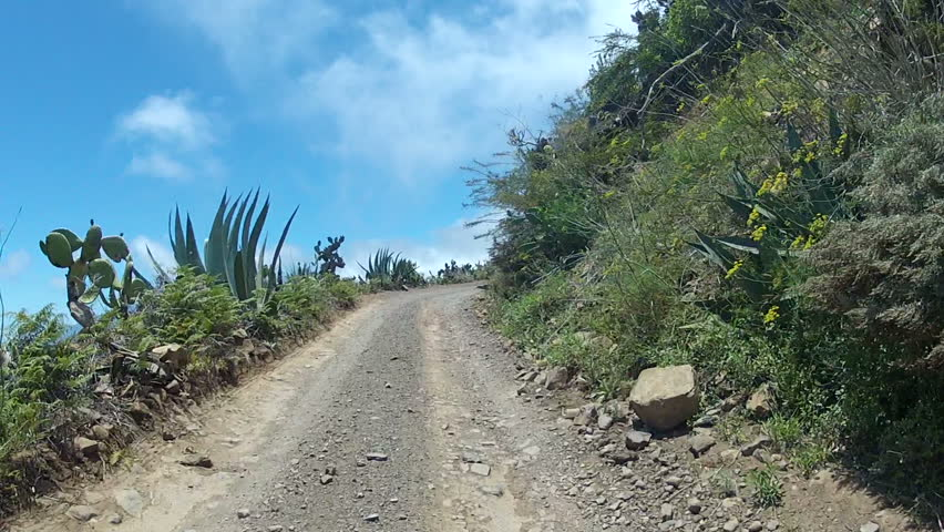 Driving Over A Dirt Road in the mountains of Tenerife, Spain.