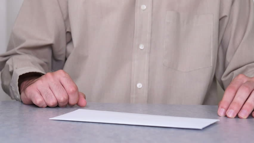 A man pulling money from an envelope. - HD stock footage clip