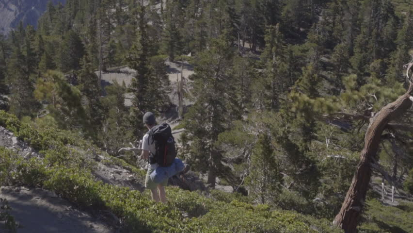 Slow Motion Backpacker alone hiking in the mountains | Shutterstock HD Video #27193747