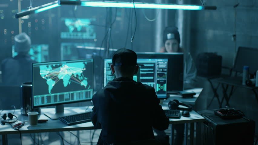Team of Internationally Wanted Teenage Hackers Infect Servers and Infrastructure with Virus. Their Hideout is Dark, Neon Lit and Has Multiple Displays. Shot on RED EPIC-W 8K Helium Cinema Camera. | Shutterstock HD Video #27246199