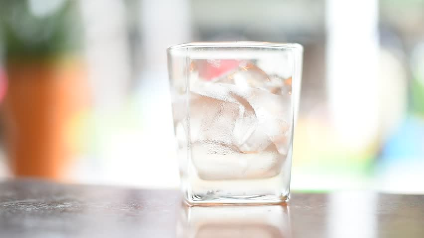 Pouring pure water in to glass. | Shutterstock HD Video #27301459