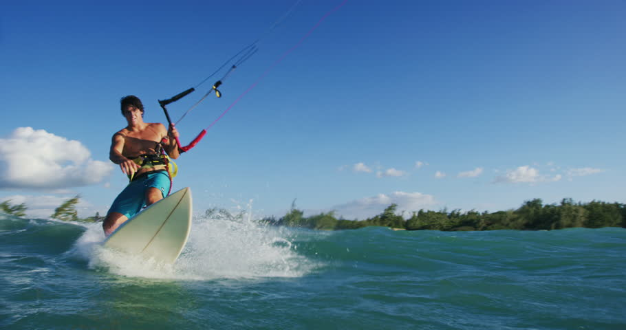 Young man kite surfing. Extreme kite boarding in slow motion. Summer fun action sports. Happiness in nature. Shot on RED   Shutterstock HD Video #27427792