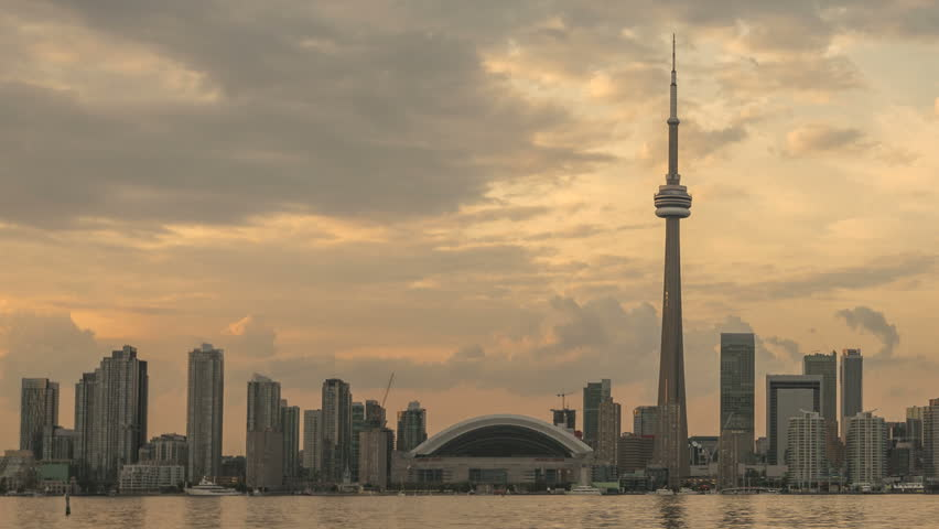 TORONTO, CANADA, AUG 15, 2012: Time lapse Toronto Skyline and CN Tower with Rogers Center during twilight and sunset with clouds