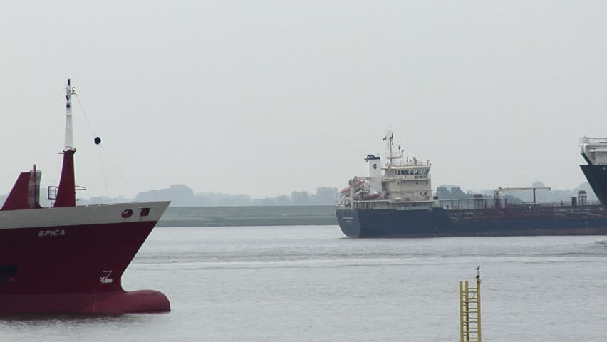 Three large freight ships passing on the river.  - HD stock video clip