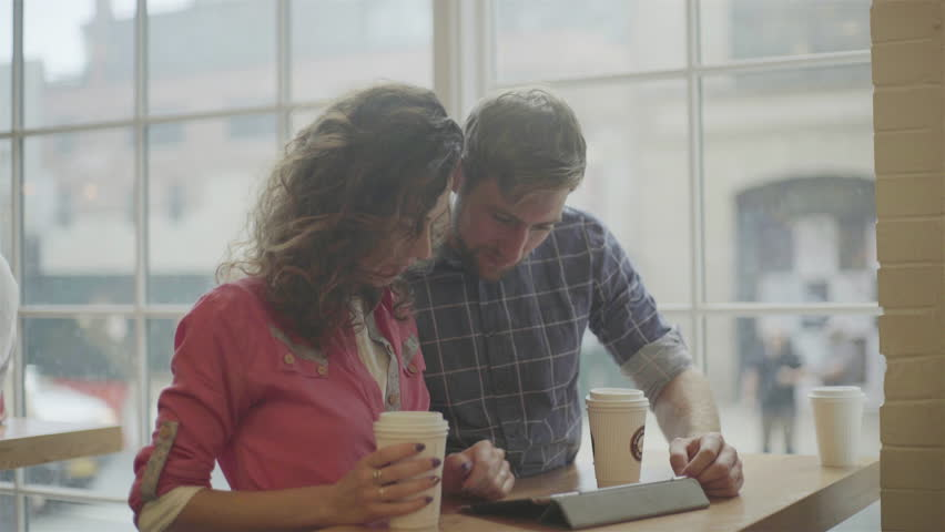 Couple using digital tablet together in coffee shop | Shutterstock HD Video #27867379