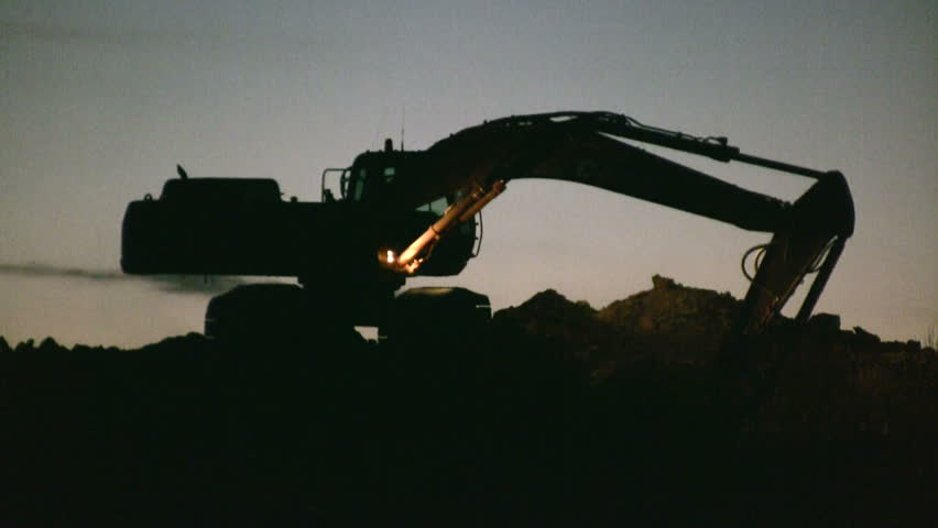 Excavator working at construction site - HD stock video clip