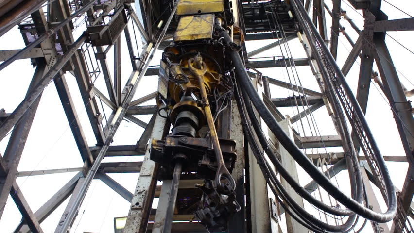 Top Drive System (TDS) and Derrick of Oil Drilling Rig - HD stock video clip