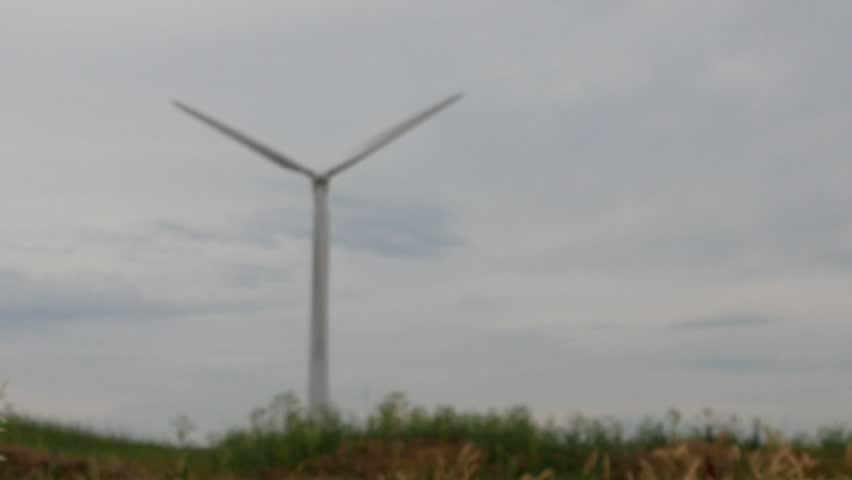 Wind turbines in wheat field under cloudy sky #27938848