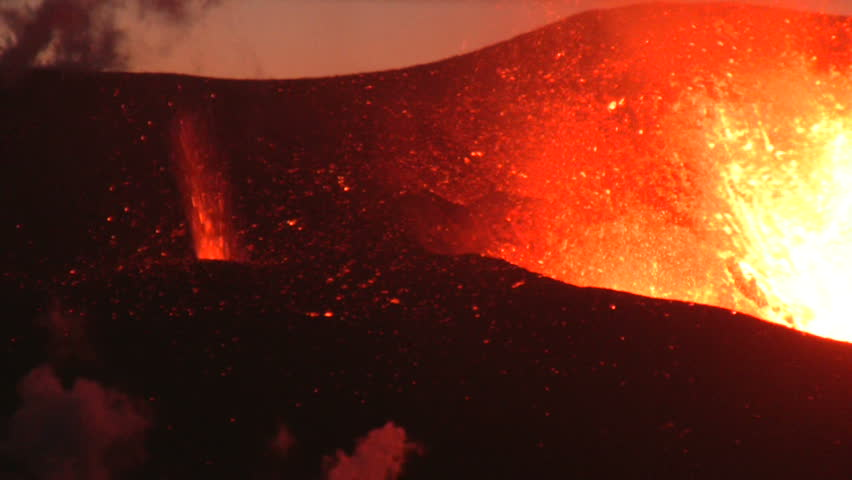 Volcanic Eruption in Iceland  2010, Eyjafjallajokull. Footage taken in extreme conditions only a half mile from the crater during frequent gas explosions from advancing lava. A mountain is born. - HD stock footage clip