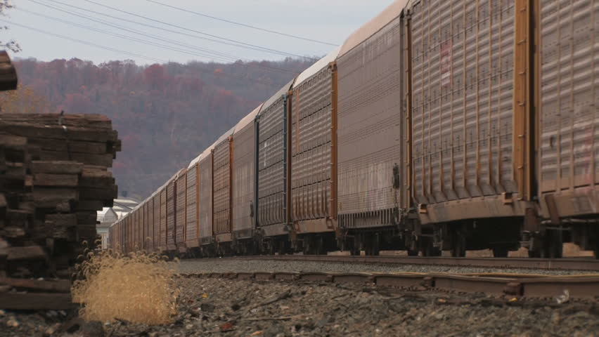 A freight train passes.