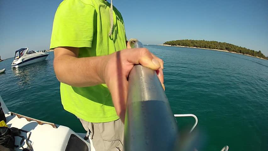 Anchor fall. Man throwing an anchor to the sea. pov.