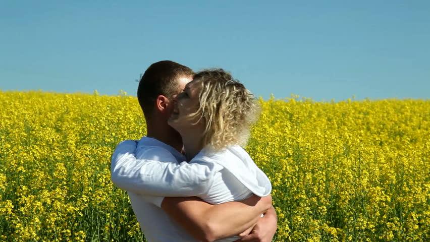 sweet couple in a field of rape