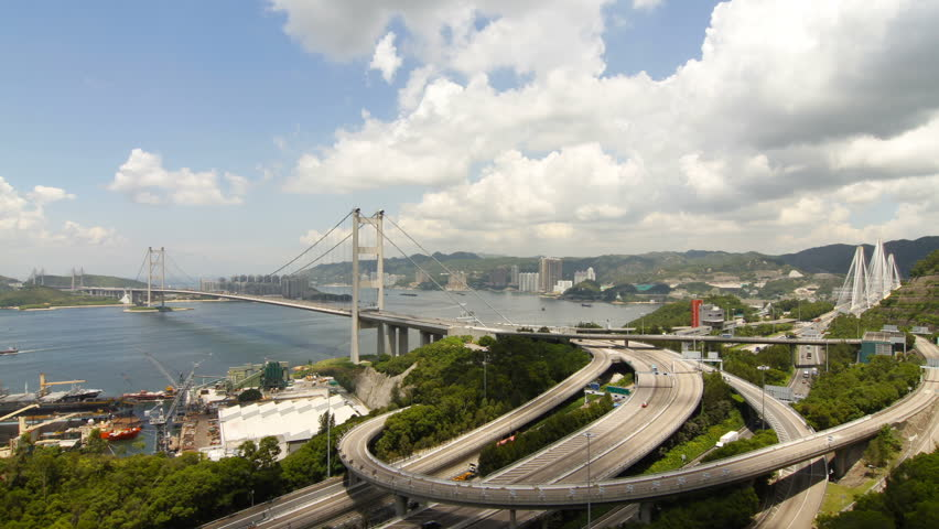 Time lapse of Tsing Ma Bridge at Summer - Tsing Ma Bridge is a bridge in Hong Kong. It is the world's seventh-longest span suspension bridge. | Shutterstock HD Video #2824708