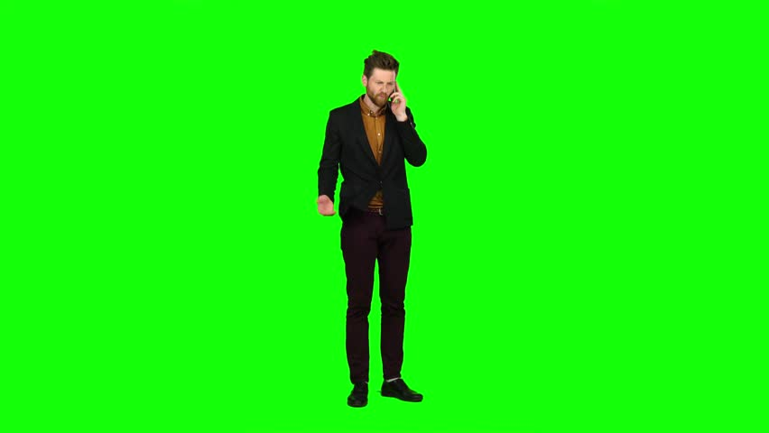 Businessman talking on the phone and nervous, shouts. Green screen | Shutterstock HD Video #28314040