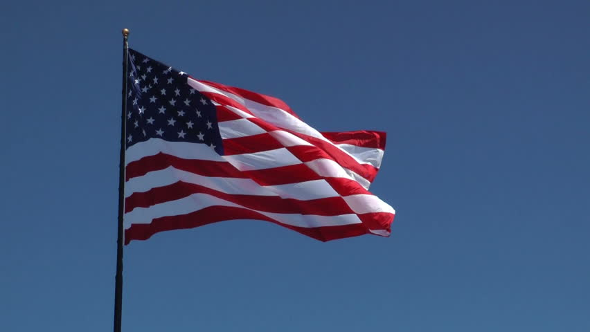 HD of American flag blowing in the breeze on a beautiful day - HD stock video clip