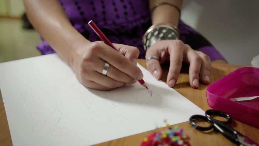 Female fashion designers drawing sketches for clothes in atelier. Sequence | Shutterstock HD Video #2842393