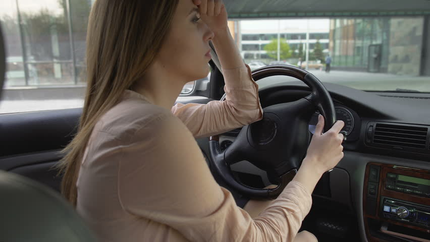 Upset business woman sitting in car and thinking about problems, sadness | Shutterstock HD Video #28492438