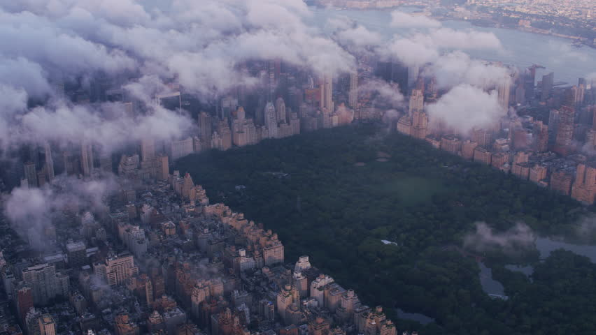 New York City circa-2017, Aerial view of Central Park and Manhattan through clouds. Shot with Cineflex and RED Epic-W Helium. #28500016