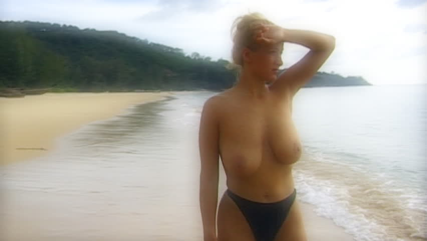 topless woman watch ocean - slow motion - filtered soft shot - Hamilton style - HD stock footage clip