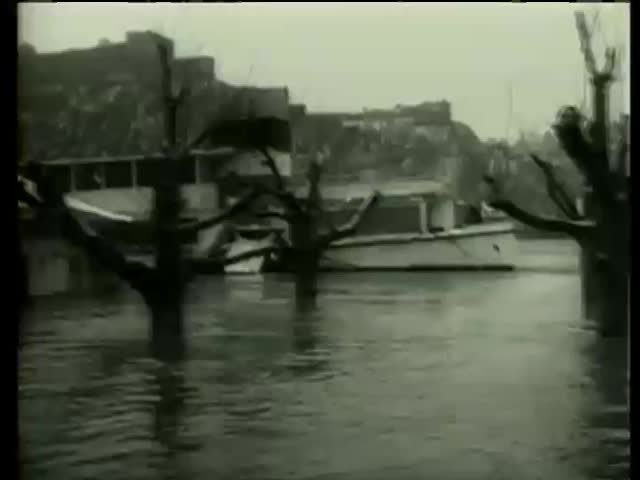 Submerged houses during the flood of Rhine and Moselle rivers Southwest Germany circa 1958-MGM PICTURES, UNIVERSAL-INTERNATIONAL NEWSREEL, USA, filmed in 1958  - SD stock video clip