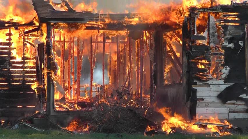 A blazing house fire has destroyed this old farmhouse.