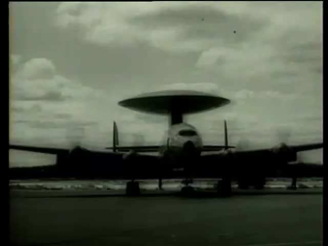 Airplane with a new distance detection radar antenna disc on runway and closeup of the antenna Massachusetts circa 1958-MGM PICTURES, UNIVERSAL-INTERNATIONAL NEWSREEL, USA, filmed in 1958 - SD stock video clip