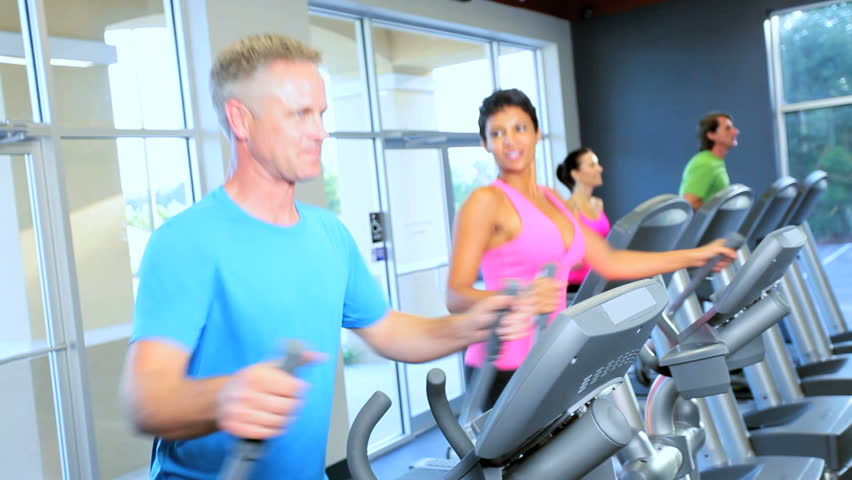 Multi ethnic males females leading modern healthy lifestyle local gym - HD stock video clip
